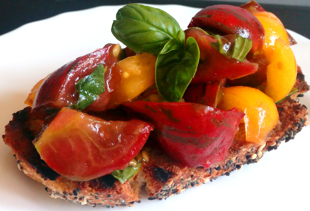 Tomatoes and Basil Bruschetta on a white plate