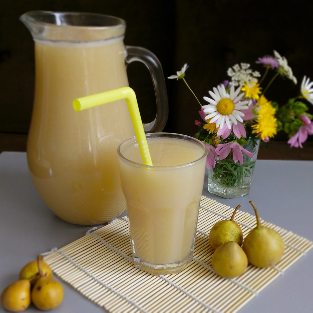 pear juice in a glass with a straw