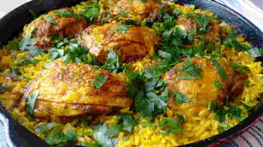 Looking for some cheap and quick recipe to make for your family? This one-skillet ginger and turmeric chicken thighs are the perfect option for busy days and lazy weeknights. My whole family really loves this dish, and yours will too! Try it now!   #onepanrecipe #onepanchickenthighs #chickenthighsandrice   simplyanchy.com