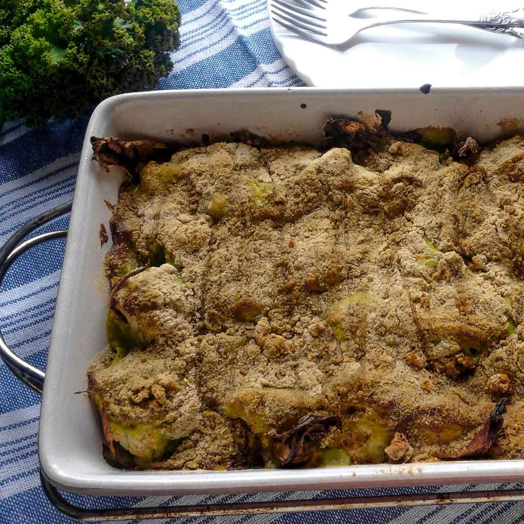 How often does your family ask for seconds of veggies at the kitchen table? With this recipe for green kale and cauliflower casserole bake, everything will change. The tender cauliflower with lovely green bechamel sauce is going to become your new favorite side dish! Try this recipe!   #cauliflowerbake #cauliflowercasserole #kalerecipe #cauliflowerrecipe   simplyanchy.com