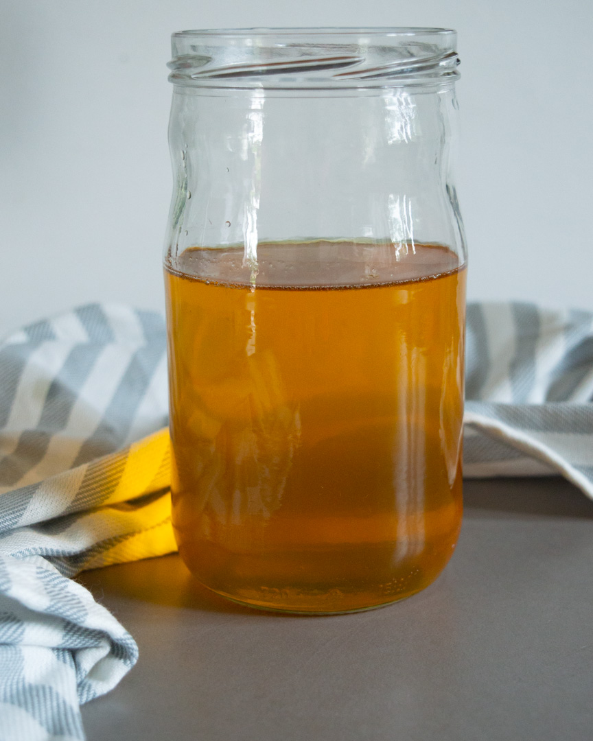 finished ghee in a glass jar