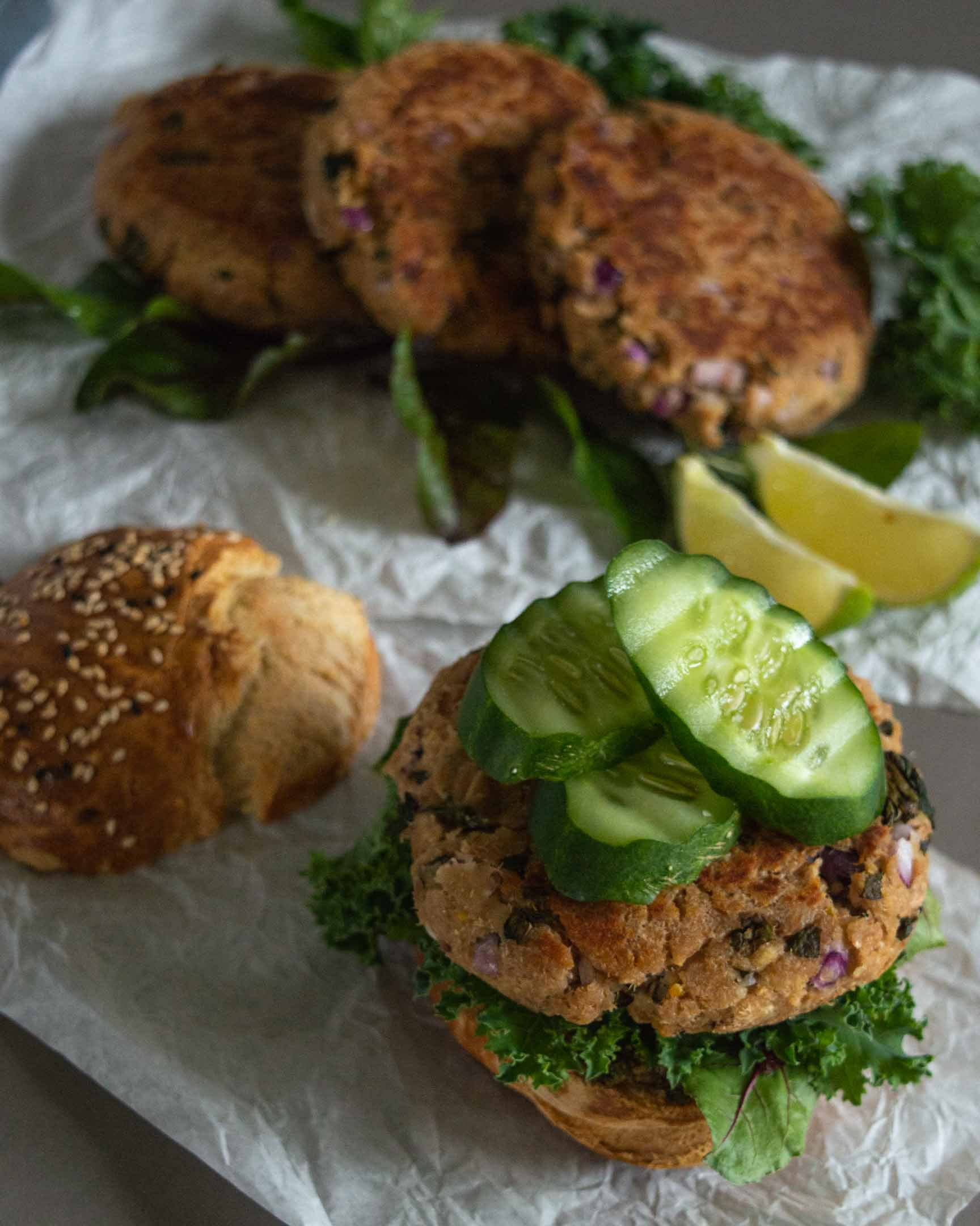 quick tuna burgers with salad, served with a bun and salad