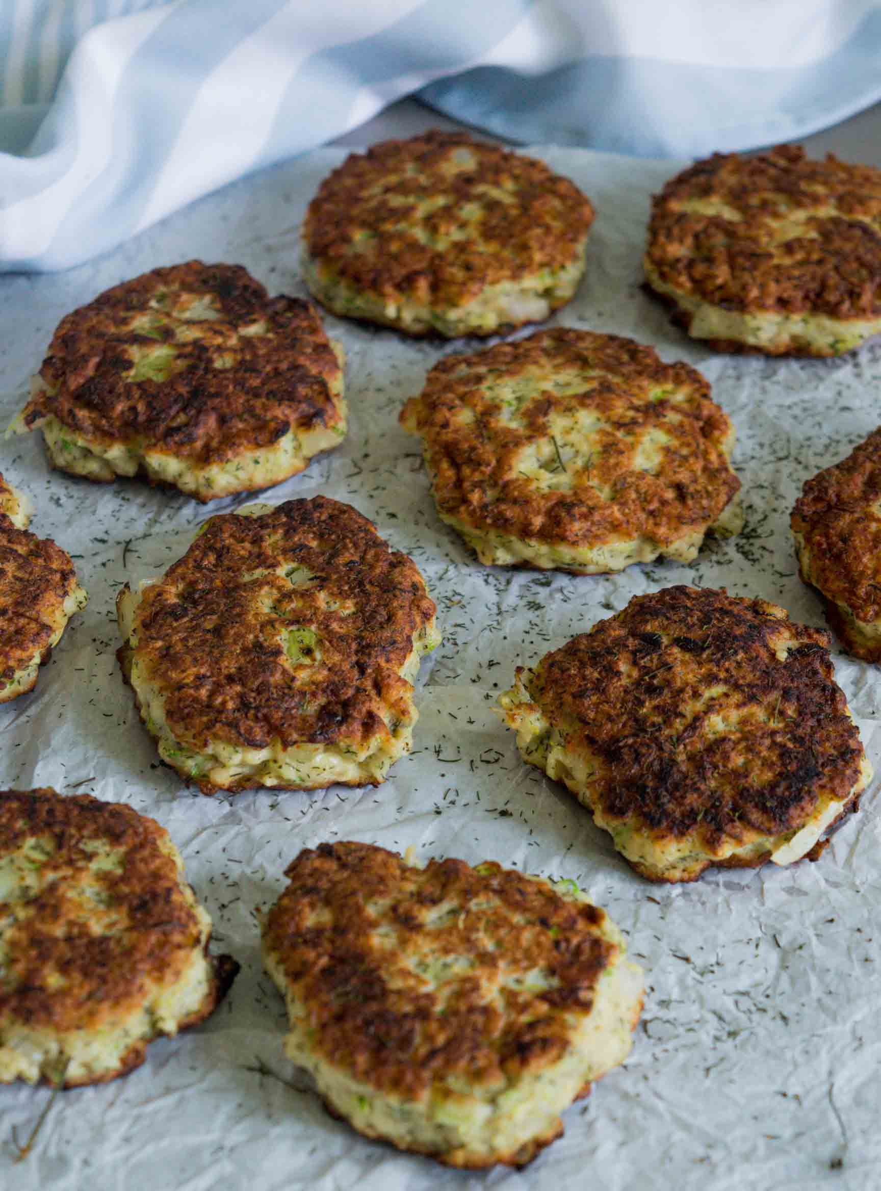 zucchini and ground turkey fritters on a parchment paper
