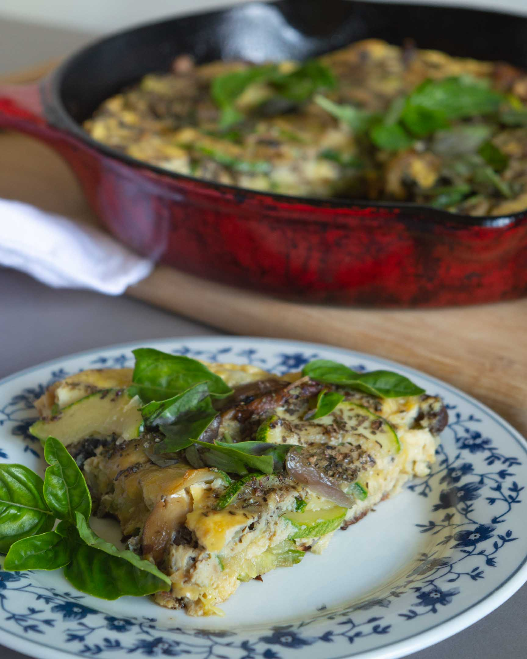 piece of zucchini and mushroom frittata on a plate