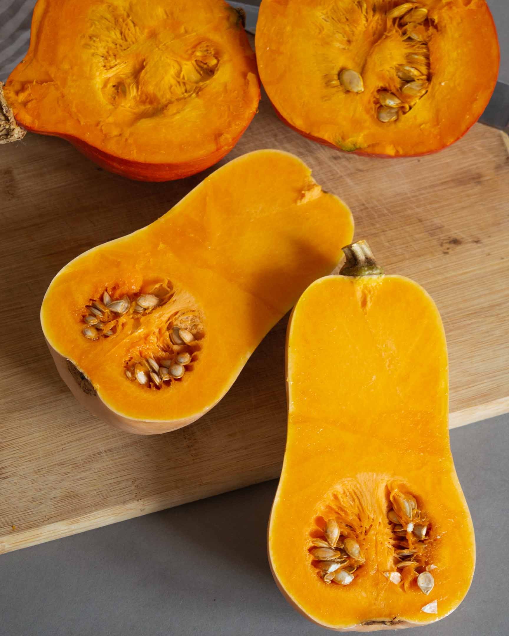 halved butternut and red kuri squash