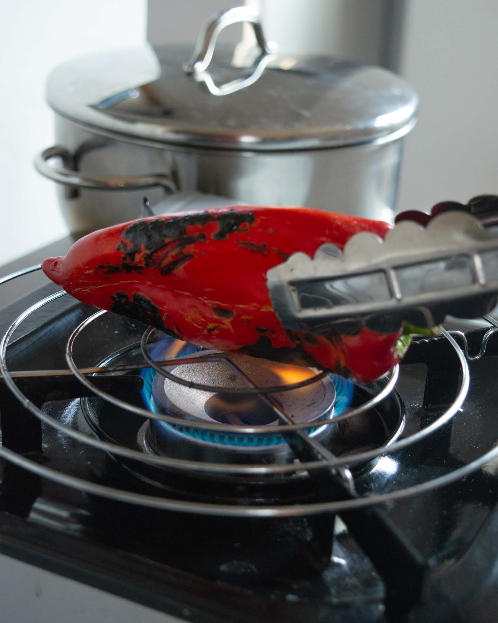 sweet red pepper on gas stove open flame