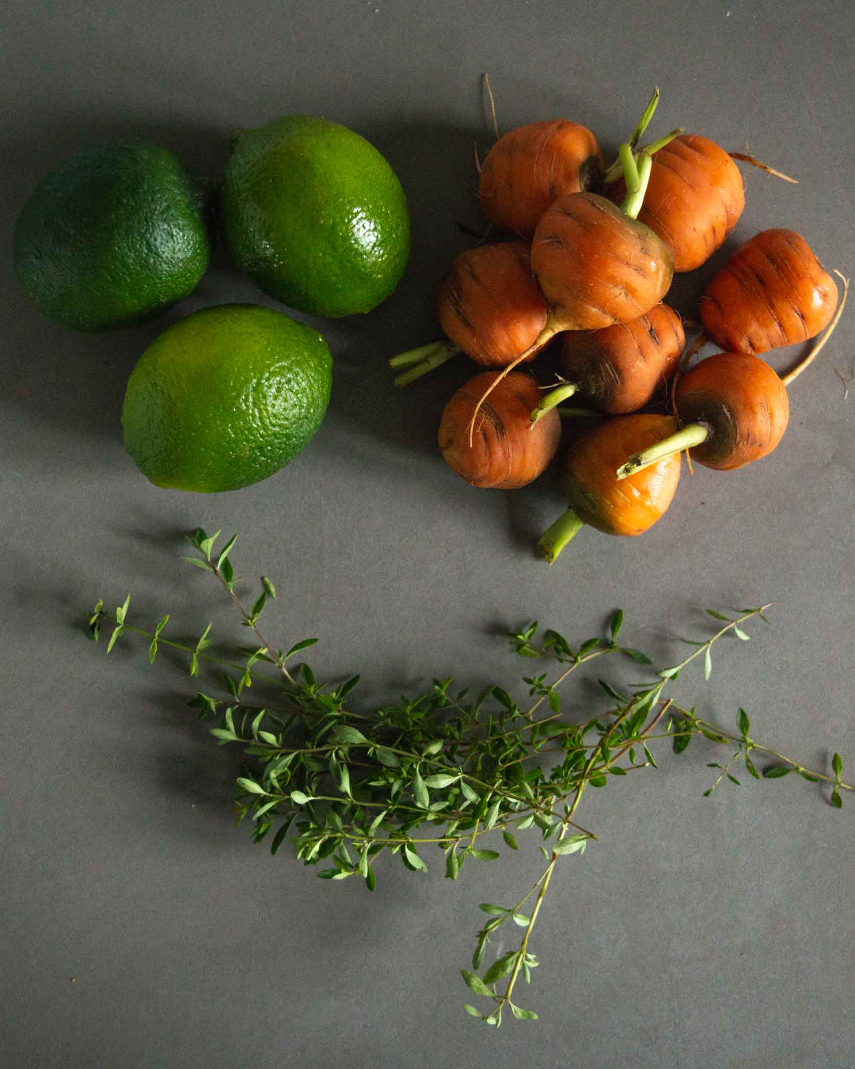 limes, Parisienne carrots and fresh thyme sprigs