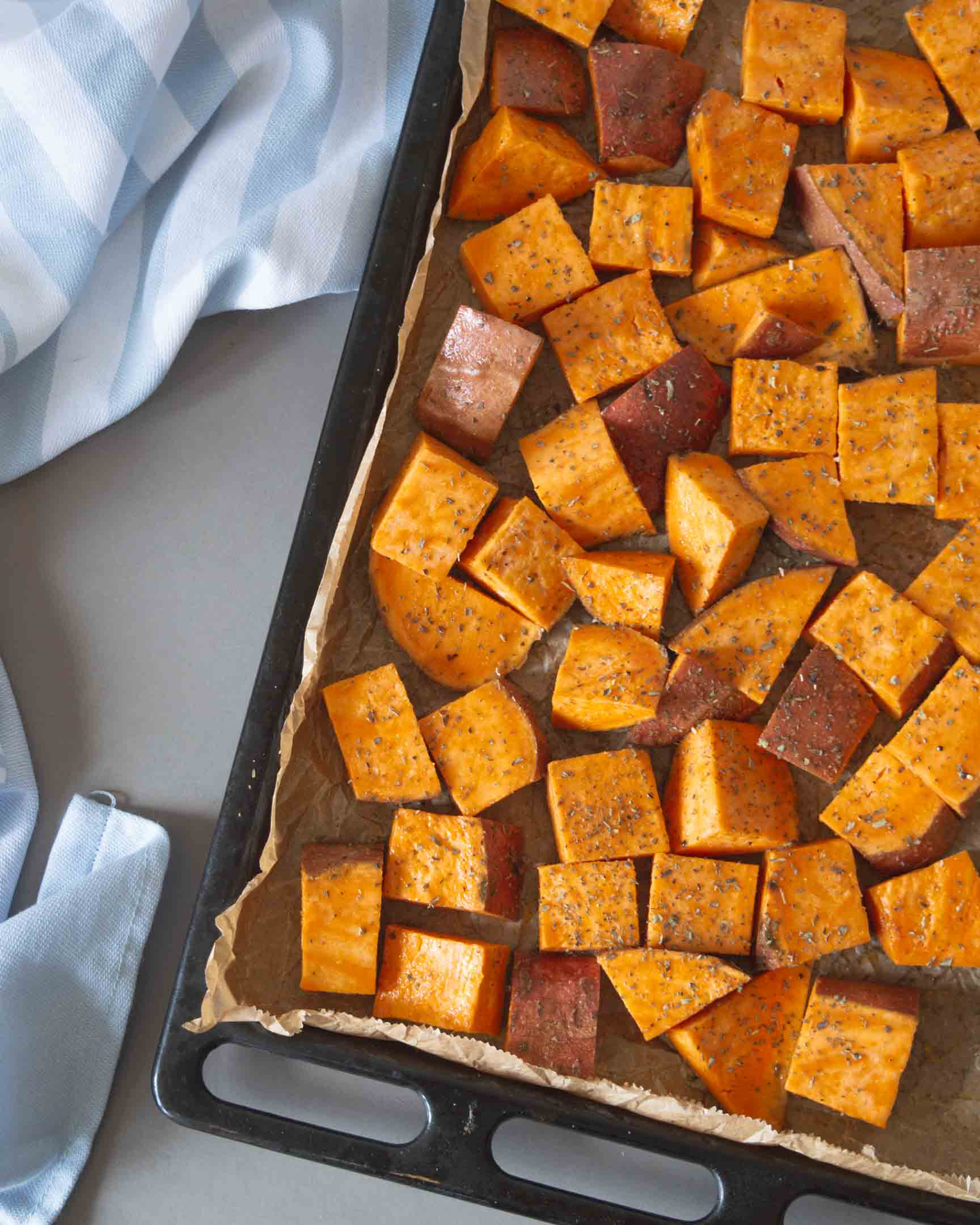 sweet potatoes on a baking tray, before roasting