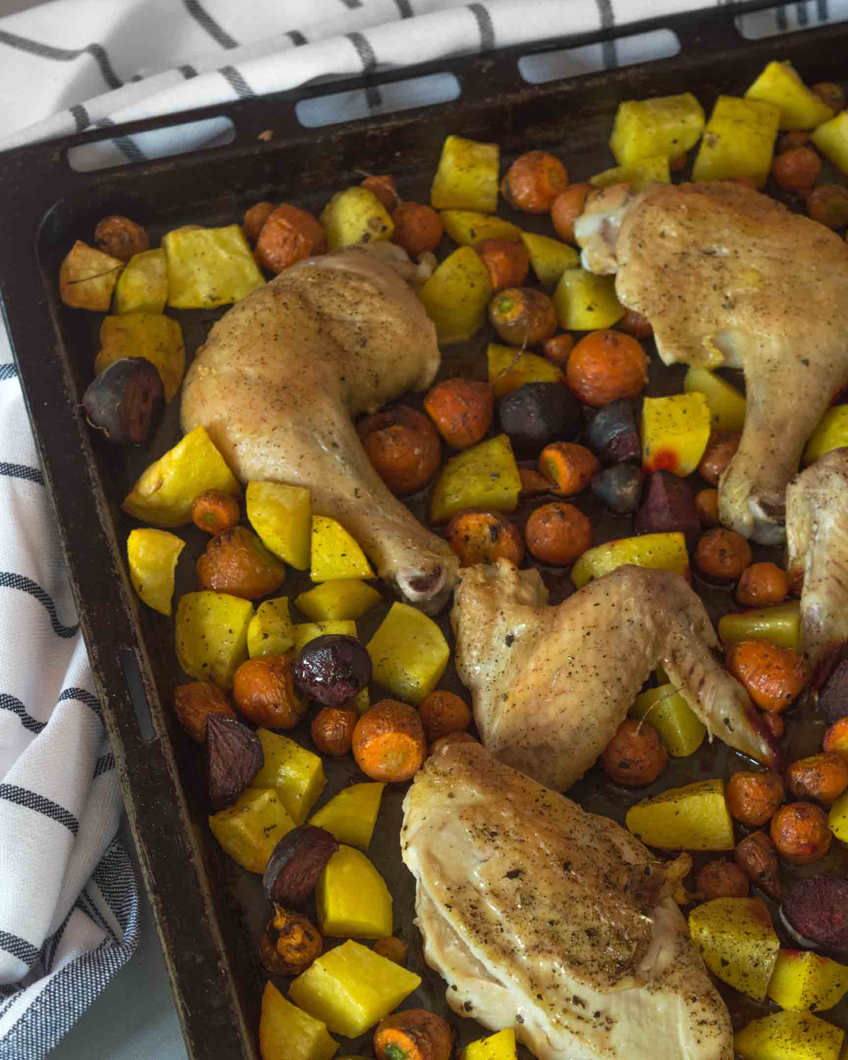 chicken and root veggies on a sheet pan