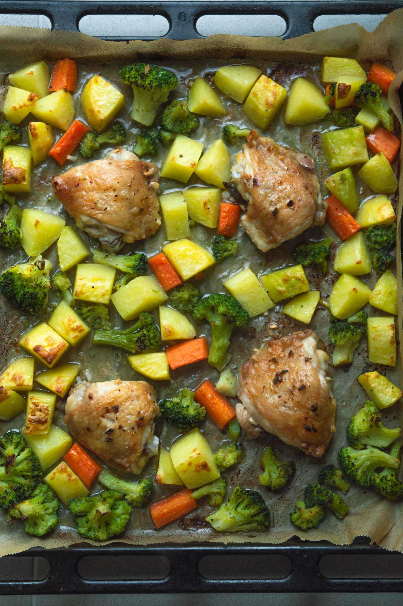 chicken thighs with broccoli and potatoes on sheet pan cooked